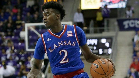 Kansas guard Lagerald Vick (2) dribbles during the second half of an NCAA college basketball game against TCU Friday, Dec. 30, 2016, in Fort Worth, Texas. (AP Photo/LM Otero)