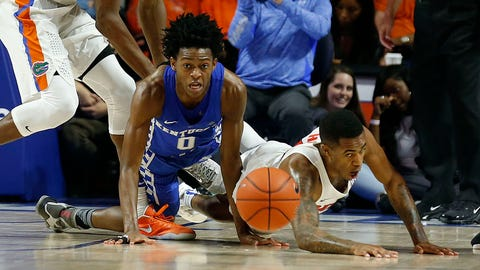Kentucky's De'Aaron Fox (0) and Florida's Kasey Hill, right, pursue a loose ball in the second half in Exactech Arena at the Stephen C. O'Connell Center in Gainesville, Fla., on Saturday, Feb. 4, 2017. Florida won, 88-66. (Charles Bertram/Lexington Herald-Leader/TNS via Getty Images)