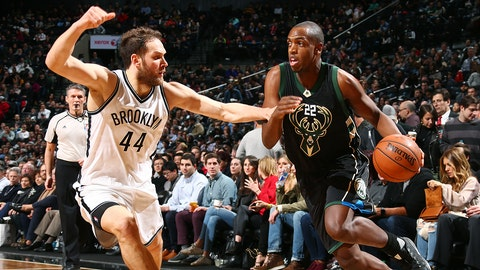BROOKLYN, NY - FEBRUARY 15: Khris Middleton #22 of the Milwaukee Bucks handles the ball during the game against the Brooklyn Nets on February 15, 2017 at Barclays Center in Brooklyn, New York. NOTE TO USER: User expressly acknowledges and agrees that, by downloading and or using this Photograph, user is consenting to the terms and conditions of the Getty Images License Agreement. Mandatory Copyright Notice: Copyright 2017 NBAE (Photo by Ned Dishman/NBAE via Getty Images)
