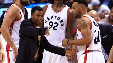 TORONTO, ON - FEBRUARY 24:  An injured Kyle Lowry (L) speaks with Norman Powell #24 of the Toronto Raptors during the first half of an NBA game against the Boston Celtics at Air Canada Centre on February 24, 2017 in Toronto, Canada.  NOTE TO USER: User expressly acknowledges and agrees that, by downloading and or using this photograph, User is consenting to the terms and conditions of the Getty Images License Agreement.  (Photo by Vaughn Ridley/Getty Images)