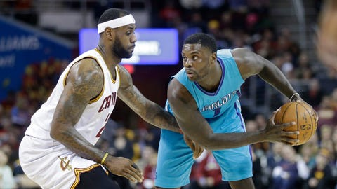 Cleveland Cavaliers' LeBron James, left, pressures Charlotte Hornets' Lance Stephenson in an NBA basketball game Friday, Jan. 23, 2015, in Cleveland. (AP Photo/Mark Duncan)