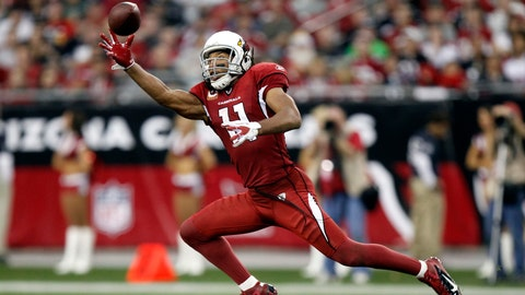 "FILE - In this Jan. 1, 2012, file photo, Arizona Cardinals wide receiver Larry Fitzgerald makes a catch against the Seattle Seahawks during an NFL football game in Glendale, Ariz. Fitzgerald is back from his latest globe-trotting adventure, this one to Southeast Asia. He jokes that the only place he's never been is Antarctica, and he plans to visit there ""late next February."" (AP Photo/Paul Connors, File)"