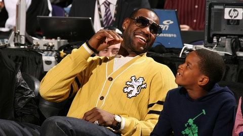 PHOENIX - FEBRUARY 14:  LeBron James of the Cleveland Cavaliers sits courtside for the Foot Locker Three-Point Shootout on All-Star Saturday Night, part of 2009 NBA All-Star Weekend at US Airways Center on February 14, 2009 in Phoenix, Arizona.  NOTE TO USER: User expressly acknowledges and agrees that, by downloading and or using this photograph, User is consenting to the terms and conditions of the Getty Images License Agreement.  Mandatory Copyright Notice: Copyright 2009 NBAE  (Photo by Nathaniel S. Butler/NBAE/Getty Images)