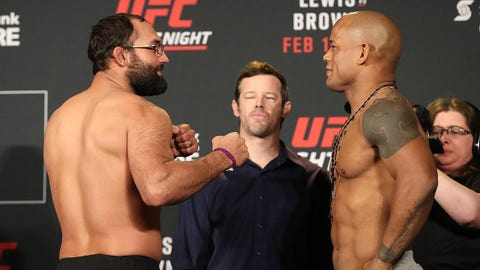 Feb 18, 2017; Halifax, NS, Canada; Johny Hendricks and Hector Lombard pose during weigh-ins as UFC matchmaker Sean Shelby looks on before UFC Fight Night at Scotiabank Centre. Mandatory Credit: Tom Szczerbowski-USA TODAY Sports