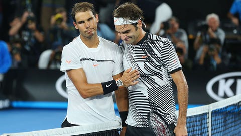 MELBOURNE, AUSTRALIA - JANUARY 29:  Roger Federer of Switzerland (R) celebrates winning in the Men's Final match against Raphael Nadal of Spain on day 14 of the 2017 Australian Open at Melbourne Park on January 29, 2017 in Melbourne, Australia.  (Photo by Michael Dodge/Getty Images)