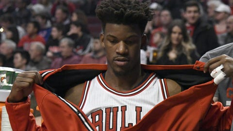 Chicago Bulls forward Jimmy Butler sits on the bench during the start of the team's NBA basketball game against the Miami Heat in Chicago, Friday, Jan. 27, 2017. Butler was taken out of the starting lineup for comments he made after a Bulls loss. (AP Photo/David Banks)
