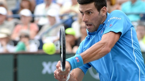 Mar 22, 2015; Indian Wells, CA, USA; Novak Djokovic (SRB) hits a shot as he defeated Roger Federer (SUI) 6-3, 6-7, 6-2 in the finals of the BNP Paribas Open at the Indian Wells Tennis Garden. Mandatory Credit: Jayne Kamin-Oncea-USA TODAY Sports