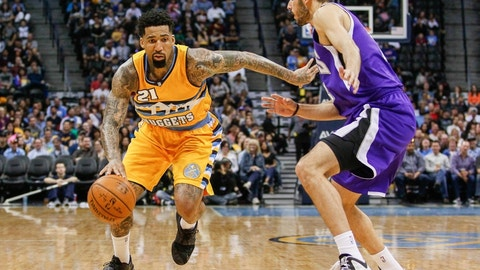 Apr 12, 2015; Denver, CO, USA; Sacramento Kings forward Omri Casspi (18) guards Denver Nuggets forward Wilson Chandler (21) in the third quarter at Pepsi Center. The Nuggets defeated the Kings 122-111. Mandatory Credit: Isaiah J. Downing-USA TODAY Sports