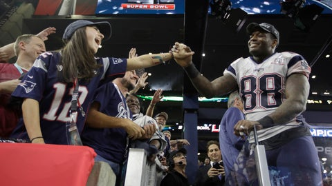New England Patriots' Martellus Bennett, right, celebrates with fans after the NFL Super Bowl 51 football game against the Atlanta Falcons Sunday, Feb. 5, 2017, in Houston. (AP Photo/Jae C. Hong)