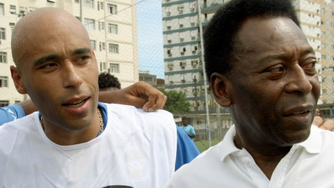 (FILE) Picture taken on April 12, 2007 of Brazilian football star Pele (R) and his son, former footballer and coach of goalkeepers in Santos FC, Edson Cholbi Nascimento, aka Edinho, in Santos. A Brazilian court has sentenced football legend Pele's son Edinho to 33 years in prison for laundering money for drug traffickers, media reports said on May 31, 2014.   AFP PHOTO / MAURICIO DE SOUZA        (Photo credit should read MAURICIO DE SOUZA/AFP/Getty Images)