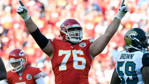 FILE - In this Nov. 6, 2016, file photo, Kansas City Chiefs offensive lineman Laurent Duvernay-Tardif (76) celebrates after a field goal by kicker Cairo Santos (5), during the second half of an NFL football game against the Jacksonville Jaguars in Kansas City, Mo.  The Chiefs have signed offensive guard Laurent Duvernay-Tardif to a five-year contract extension, locking up the former sixth-round pick before he reaches free agency next season. Terms of the contract announced Tuesday, Feb. 28, 2017, weren't revealed, but the deal is believed to be worth $41.25 million, with $20 million guaranteed. That would make him one of the highest-paid offensive guards in the NFL. (AP Photo/Ed Zurga, File)