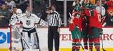Shorthanded Wild dethrone Kings in overtime