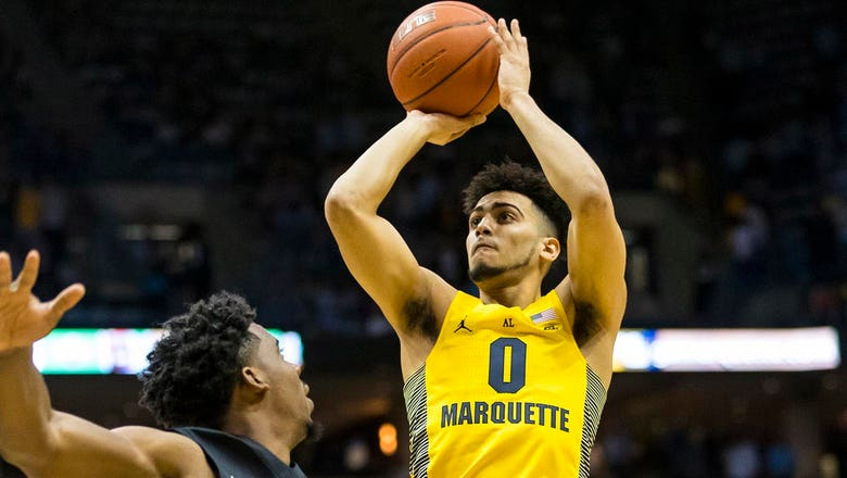 Brotherly rivalry fueling Marquette's Howard