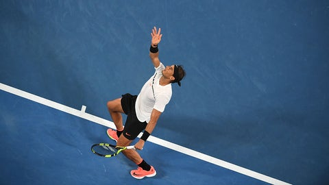 Rafael Nadal of Spain serves against Roger Federer of Switzerland during the men's singles final on day 14 of the Australian Open tennis tournament in Melbourne on January 29, 2017. / AFP / SAEED KHAN / IMAGE RESTRICTED TO EDITORIAL USE - STRICTLY NO COMMERCIAL USE        (Photo credit should read SAEED KHAN/AFP/Getty Images)
