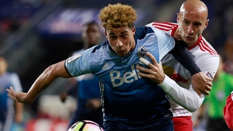 Vancouver Whitecaps forward Erik Hurtado (19) tries to control the ball as New York Red Bulls defender Aurelien Collin (78) defends during the second half of a CONCACAF Champions League quarterfinal soccer match, Wednesday, Feb. 22, 2017, in Harrison, N.J. (AP Photo/Julio Cortez)