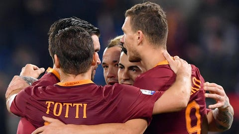 AS Roma's Edin Dzeko (R) celebrates with his teammates after scoring the 1-0 goal during the Italy's Cup quarter final soccer match between AS Roma and AC Cesena at the Olimpico stadium in Rome, Italy, 01 February 2017.  ANSA/ETTORE FERRARI