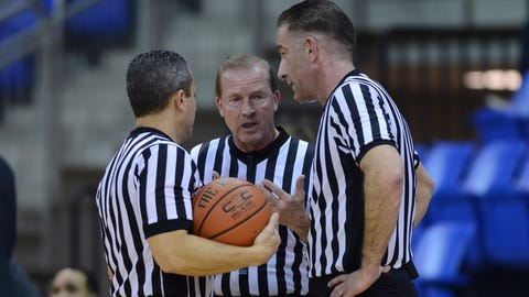HAMDEN, CT - JANUARY 20: The referee's discuss a call during the game as the Canisius Golden Griffins takes on the Quinnipiac Bobcats on January 20, 2017 at the TD Bank Sports Center in Hamden, Connecticut. (Photo by Williams Paul/Icon Sportswire) (Icon Sportswire via AP Images)