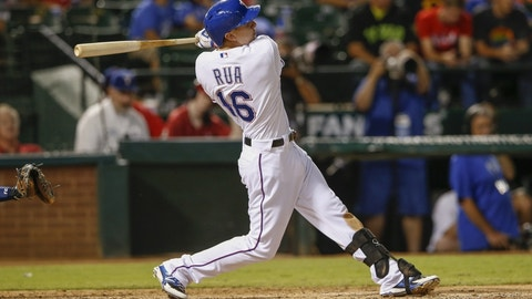 Sep 24, 2014; Arlington, TX, USA; Texas Rangers first baseman Ryan Rua (16) hits a three run home run against the Houston Astros during the seventh inning at Globe Life Park in Arlington. Mandatory Credit: Kevin Jairaj-USA TODAY Sports