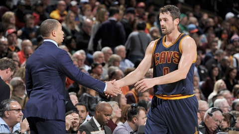 CLEVELAND, OH - NOVEMBER 3:  Kevin Love #0, and Tyronn Lue of the Cleveland Cavaliers high five during the game against the Boston Celtics on November 3, 2016 at Quicken Loans Arena in Cleveland, Ohio. NOTE TO USER: User expressly acknowledges and agrees that, by downloading and/or using this Photograph, user is consenting to the terms and conditions of the Getty Images License Agreement. Mandatory Copyright Notice: Copyright 2016 NBAE  (Photo by David Liam Kyle/NBAE via Getty Images)