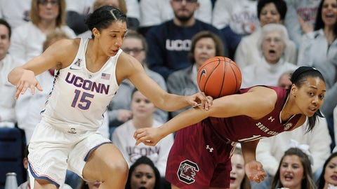 Connecticut's Gabby Williams, left, and South Carolina's Allisha Gray, right, go for a loose rebound in the first half of an NCAA college basketball game, Monday, Feb. 13, 2017, in Storrs, Conn. (AP Photo/Jessica Hill)