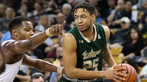 ORLANDO, FL - JANUARY 17:  South Florida Bulls guard Troy Holston (25) is guarded by UCF Knights guard Matt Williams (12) during the basketball game between the UCF Knights and the South Florida Bulls on January 17, 2017 at the CFE Arena in Orlando, FL. (Photo by Joe Petro/Icon Sportswire) (Icon Sportswire via AP Images)