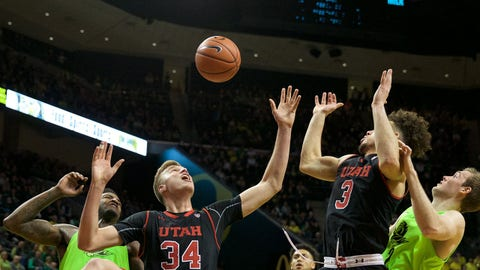 Feb 16, 2017; Eugene, OR, USA; Utah Utes forward Jayce Johnson (34) and Utah Utes guard Devon Daniels (3) and Oregon Ducks guard Casey Benson (2) and Oregon Ducks forward Jordan Bell (1) fight for a loose ball in the first half at Matthew Knight Arena. Mandatory Credit: Scott Olmos-USA TODAY Sports