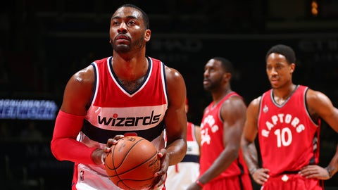 WASHINGTON, DC -  JANUARY 8: John Wall #2 of the Washington Wizards shoots a free throw against the Toronto Raptors  on January 8, 2016 at Verizon Center in Washington, DC. NOTE TO USER: User expressly acknowledges and agrees that, by downloading and or using this Photograph, user is consenting to the terms and conditions of the Getty Images License Agreement. Mandatory Copyright Notice: Copyright 2016 NBAE (Photo by Ned Dishman/NBAE via Getty Images)