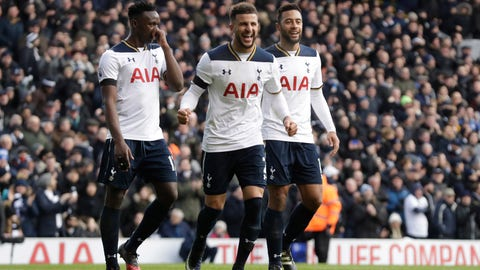 Tottenham Hotspur's Kyle Walker, center, celebrates setting up Harry Kane's second goal during the English Premier League soccer match between Tottenham Hotspur and West Bromwich Albion at White Hart Lane stadium in London, Saturday, Jan. 14, 2017. (AP Photo/Matt Dunham)