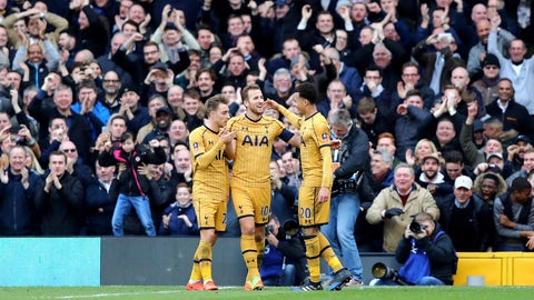 LONDON, ENGLAND - FEBRUARY 19:  Harry Kane of Tottenham Hotspur (C) celebrates with team mates as he scores their third goal and completes his hat trick during The Emirates FA Cup Fifth Round match between Fulham and Tottenham Hotspur at Craven Cottage on February 19, 2017 in London, England.  (Photo by Clive Rose/Getty Images)