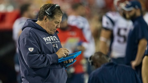 KANSAS CITY, MO - SEPTEMBER 29: New England Patriots Bill Belichick is shown on his iPad after Kansas City Chiefs scored a 2-yard touchdown reception during fourth quarter action at Arrowhead Stadium on September 29, 2014. (Photo by Matthew J. Lee/The Boston Globe via Getty Images)