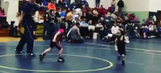 Young boy wants no part of wrestling girl, turns match into track meet