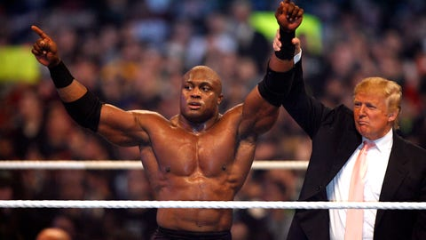 "Donald Trump and WWE wrestler Bobby Lashley celebrate their victory over Vince McMahon at the main event of the night, ""Hair vs. Hair"", between Vince McMahon and Donald Trump. WrestleMania 23 at Detroit's Ford Field in Detroit, Michigan on April 1, 2007. (Photo by Leon Halip/WireImage)"