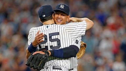 New York Yankees' Alex Rodriguez, rear, embraces first baseman Mark Teixeira after his final baseball game as a Yankee player, against the Tampa Bay Rays at Yankee Stadium in New York, Friday, Aug. 12, 2016. Rodriguez took the field as a third baseman in the ninth inning. Teixeira has announced he will retire at the end of the season. (AP Photo/Kathy Willens)