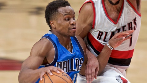 Dallas Mavericks guard Yogi Ferrell, left, dribbles past Portland Trail Blazers guard Evan Turner during the second half of an NBA basketball game in Portland, Ore., Friday, Feb. 3, 2017. (AP Photo/Craig Mitchelldyer)