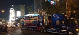 NASCAR hauler parade greeted by rowdy fans on Las Vegas strip