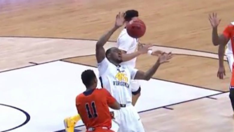 West Virginia player takes a missile of a pass directly to the face