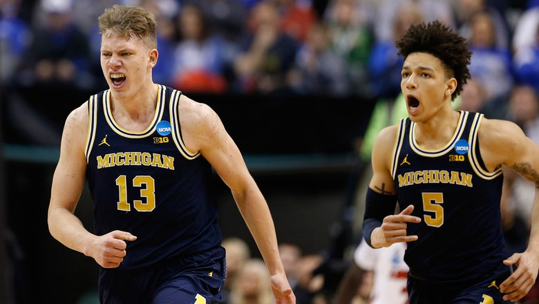 Michigan upsets No. 2 seed Louisville, continues amazing run of invincibility