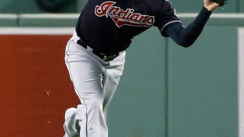 Cleveland Indians right fielder Lonnie Chisenhall catches a line drive hit by Boston Red Sox's Mookie Betts during the first inning in Game 3 of baseball's American League Division Series, Monday, Oct. 10, 2016, in Boston. (AP Photo/Elise Amendola)