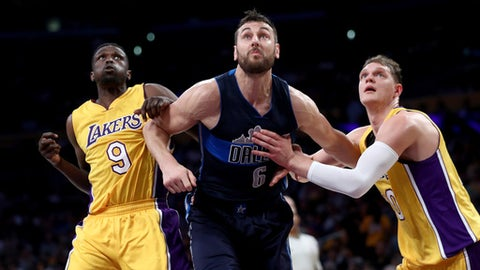 LOS ANGELES, CA - NOVEMBER 08:  Timofey Mozgov #20 and Luol Deng #9 of the Los Angeles Lakers box out Andrew Bogut #6 of the Dallas Mavericks during the first half of a game  at Staples Center on November 8, 2016 in Los Angeles, California.NOTE TO USER: User expressly acknowledges and agrees that, by downloading and or using this photograph, User is consenting to the terms and conditions of the Getty Images License Agreement.  (Photo by Sean M. Haffey/Getty Images)