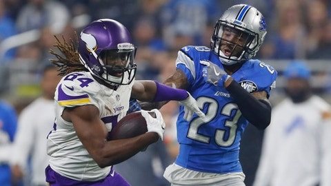 Minnesota Vikings wide receiver Cordarrelle Patterson (84) pulls away from Detroit Lions cornerback Darius Slay (23) during the second half of an NFL football game, Thursday, Nov. 24, 2016, in Detroit. (AP Photo/Paul Sancya)
