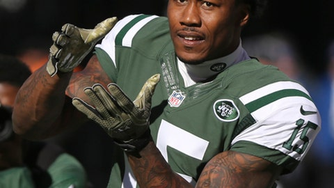 FILE - In this Nov. 13, 2016, file photo, New York Jets wide receiver Brandon Marshall (15) warms up before playing against the Los Angeles Rams, in East Rutherford, N.J. Arizona's Larry Fitzgerald, Miami's Mike Pouncey and the New York Jets' Brandon Marshall are among the 32 players eligible for the Walter Payton NFL Man of the Year Award. Named for the late Hall of Fame running back, the award recognizes a player's community service and performance on the field. The NFL announced the players on Wednesday, Dec. 7, 2016. (AP Photo/Seth Wenig, File)