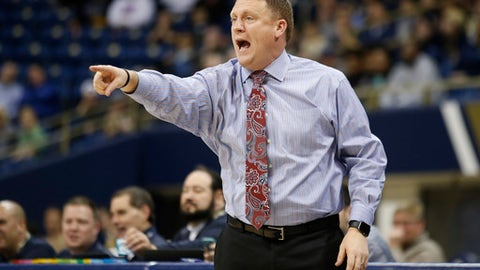 Rice coach Mike Rhoades shouts to his players during the first half of an NCAA college basketball game against Pittsburgh in Pittsburgh on Saturday, Dec. 17, 2016. (AP Photo/Jared Wickerham)