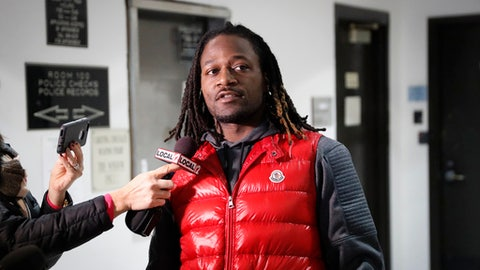 """FILE - In this Jan. 4, 2017, file photo, Cincinnati Bengals cornerback Adam """"Pacman"""" Jones speaks to reporters as he is released from the Hamilton County Justice Center in Cincinnati. Jones is apologizing through his attorneys after Cincinnati police released video showing his raucous, often-vulgar reaction to his latest arrest. (AP Photo/John Minchillo, File)"""