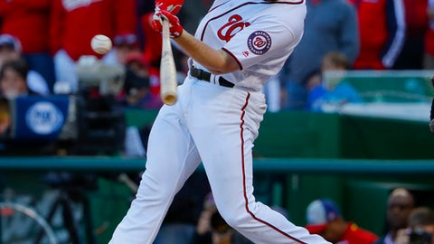 FILE - In this Oct. 9, 2016 file photo, Washington Nationals' Daniel Murphy hits an RBI-single against the Los Angeles Dodgers during the seventh inning in Game 2 of baseball's National League Division Series at Nationals Park in Washington. Murphy said Friday, Feb. 17, 2017, that he recently spent some time working on batting with Tim Tebow, the Heisman Trophy winner and former NFL quarterback who is taking a crack at baseball. Tebow is expected to be in minor league camp with the New York Mets next month. (AP Photo/Pablo Martinez Monsivais, File)