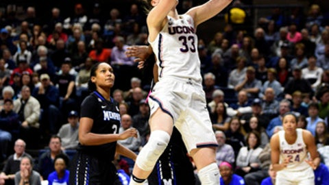 Connecticut's Katie Lou Samuelson scores two of her game-high 29 points during the first half of her team's 91-48 victory over Memphis in an NCAA college basketball game in Storrs, Conn. (AP Photo/Fred Beckham)