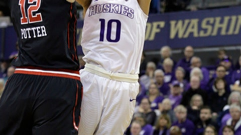 Washington's Kelsey Plum (10) shoots as Utah's Emily Potter defends in the second half of an NCAA college basketball game Saturday, Feb. 25, 2017, in Seattle. (AP Photo/Elaine Thompson)