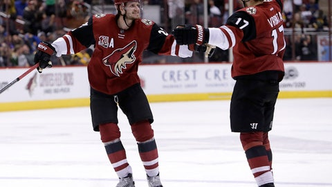 Arizona Coyotes right wing Radim Vrbata (17) celebrates with Oliver Ekman-Larsson after scoring a third period goal against the Buffalo Sabres during an NHL hockey game, Sunday, Feb. 26, 2017, in Glendale, Ariz. Arizona defeated Buffalo 3-2. (AP Photo/Rick Scuteri)