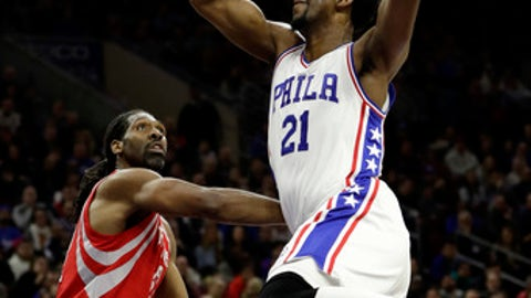 Philadelphia 76ers' Joel Embiid (21) goes in for a shot against Houston Rockets' Nene Hilario (42) during the first half of an NBA basketball game, Friday, Jan. 27, 2017, in Philadelphia. (AP Photo/Matt Slocum)