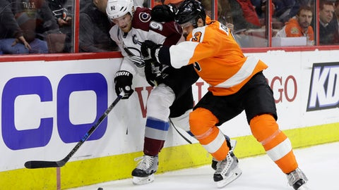 Colorado Avalanche's Gabriel Landeskog, left, and Philadelphia Flyers' Radko Gudas battle for the puck during the first period of an NHL hockey game, Tuesday, Feb. 28, 2017, in Philadelphia. (AP Photo/Matt Slocum)