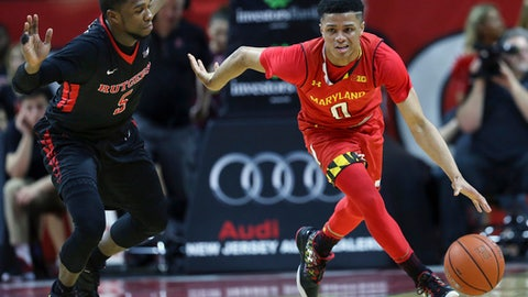 Maryland guard Anthony Cowan (0) bring the ball up as Rutgers guard Mike Williams (5) gives chase during the second half of an NCAA college basketball game Tuesday, Feb. 28, 2017, in Piscataway, N.J. Maryland won 79-59. (AP Photo/Mel Evans)